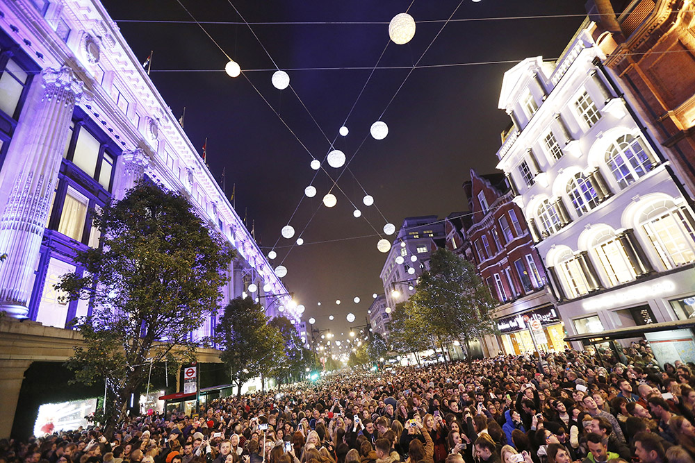 LONDON, ENGLAND - NOVEMBER 01: A general view of the atmosphere during The World Famous Oxford Street Christmas Lights Switch On Event taking place at the Pandora Flagship Store on November 1, 2015 in London, England. (Photo by Tabatha Fireman/Getty Images for New West End Company)