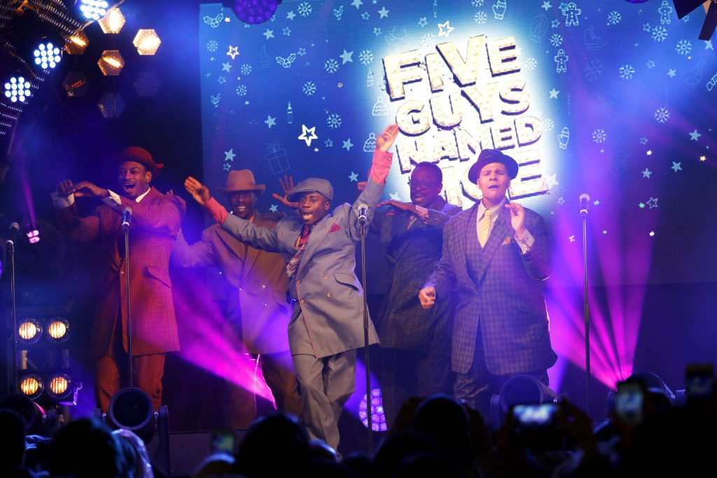 EDITORIAL USE ONLY Five Guys Named Moe perform at the Oxford Street Christmas Lights Switch On in central London, in partnership with NSPCC 'Light Up Christmas for Children' campaign. PRESS ASSOCIATION Photo. Picture date: Tuesday November 7, 2017. Now in its 58th year of celebrations, the Oxford Street Christmas Lights will use 750,000 LED bulbs and 1,778 baubles in a snowfall theme blanketing the whole mile of shopping street. Photo credit should read: David Parry/PA Wire